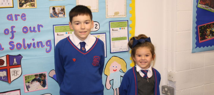 Two primary school children help their local NHS spread a very important message